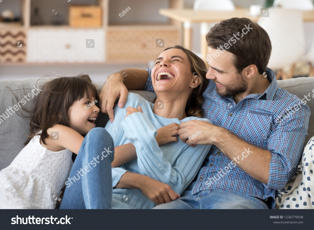 stock-photo-cheerful-people-sitting-on-couch-in-living-room-have-fun-little-daughter-tickling-mother-laughing-1236779938.jpg